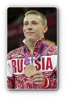 Russian gymnast Denis Ablyazin displays his bronze medal for the men's floor exercise finals at the 2012 Summer Olympics, Sunday, Aug. 5, 2012, in London. (AP Photo/Julie Jacobson)